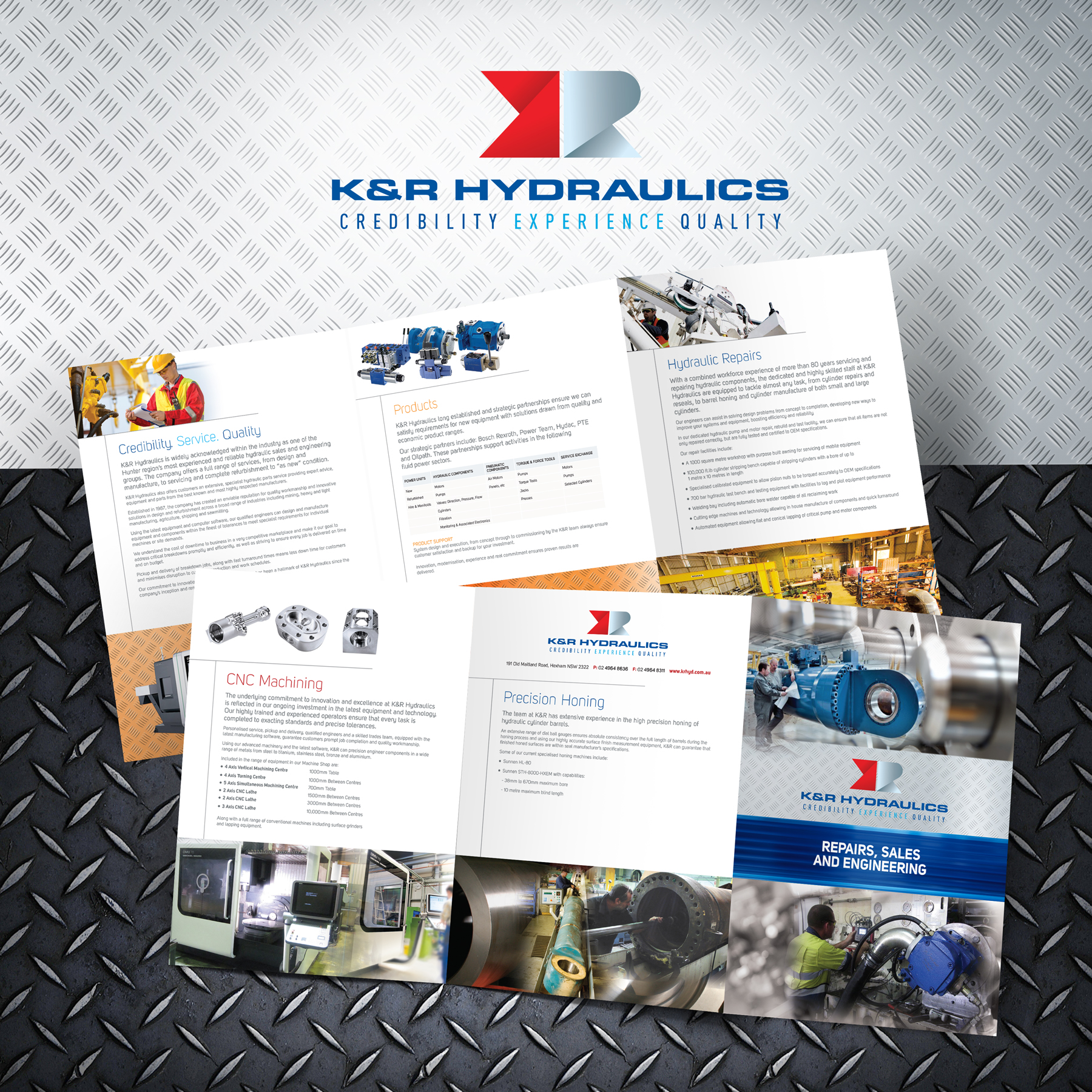 K&R Hydraulics brochure display banner on metal background